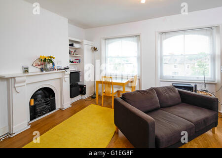 Belsize Lane, Hampstead. Living area with dining table. - Stock Photo