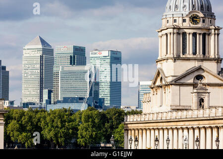 View of the landmark buildings of Canary Wharf and the Royal Naval College in London - Stock Photo