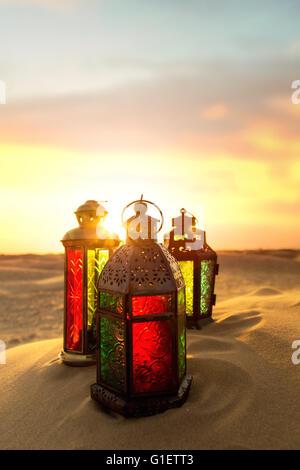 Ramadan Lantern on desert during a sunset in Dubai United Arab Emirates - Stock Photo