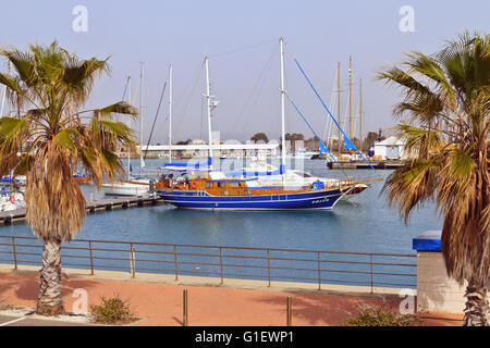 Wooden hull yacht moored in Burriana Harbour, Spain - Stock Photo