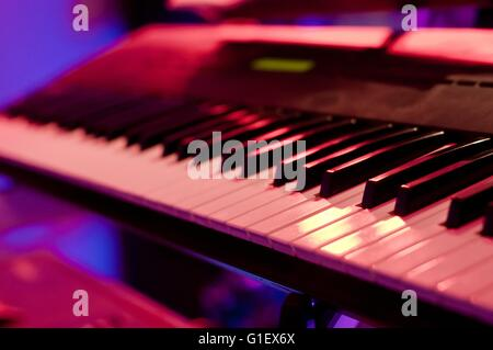 Piano keyboard in concert filled with light - Stock Photo