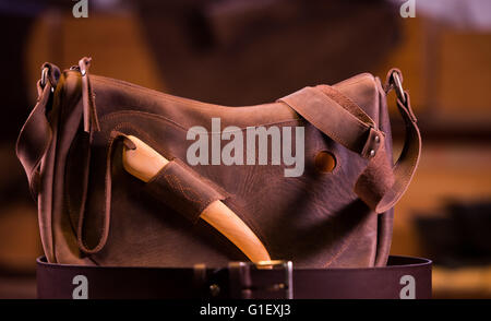leather goods craftsman at work in his workshop, France - Stock Photo