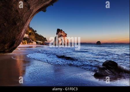 Cathedral Cove at sunrise, Coromandel Peninsula, New Zealand - Stock Photo