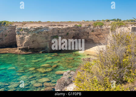 Rocky cliff and transparent sea in the natural reserve of Plemmirio, near Syracuse - Stock Photo