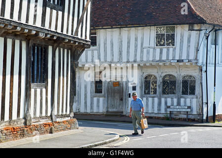 Senior man walking in the medieval village of Lavenham, Suffolk, England UK - Stock Photo