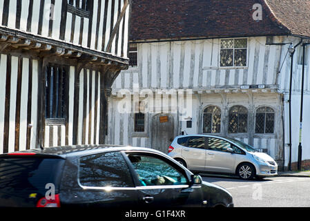 Cars in the medieval village of Lavenham, Suffolk, England UK - Stock Photo