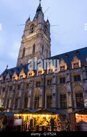 Belfry of Ghent with cloth hall in Belgium during Christmas - Stock Photo