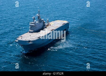 The French Navy Mistral class amphibious assault ship BPC Dixmude underway awaiting the arrival of an U.S Marine - Stock Photo
