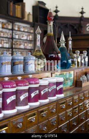 Old fashioned Pharmaceutical display in a Victorian Apothecary - Stock Photo