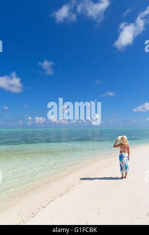 Woman on sandbank, South Male Atoll, Kaafu Atoll, Maldives