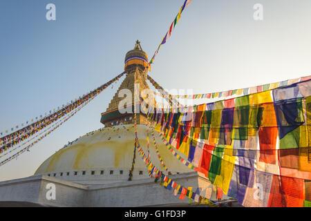 Boudhanath Stupa with hundreds of Pigeons and Prayer flags in Kathmandu, Nepal - Stock Photo