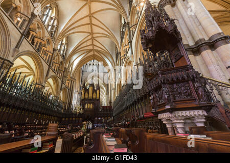 Organ in Lincoln Cathedral  choir , Stalls St Hugh's Choir, Lincoln, Lincolnshire, England, UK - Stock Photo