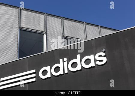 Adidas logo on a wall - Stock Photo