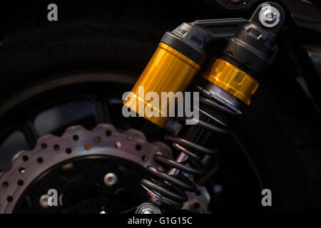 Color shot of a motorcycle shock absorber. - Stock Photo