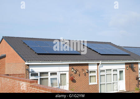 Solar panels on roof of Bungalow - Stock Photo