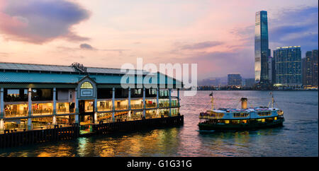 The Star ferry terminal, and the International Commerce Centre, ICC, Victoria harbor, Hong Kong, China. - Stock Photo