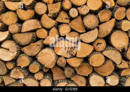Wood pile stacked and ready for winter, background texture. - Stock Photo