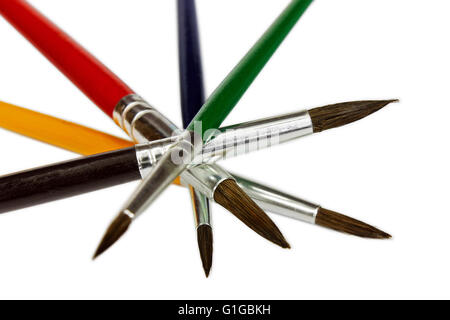 Artistic colored paint brushes isolated on white background - Stock Photo