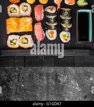 Sushi set on dark background - Stock Photo