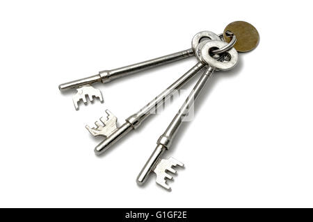 A bunch of old keys isolated on white background - Stock Photo