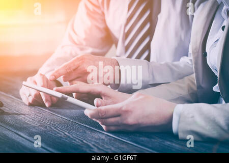 business meeting executive consulting review career report tablet - stock image - Stock Photo