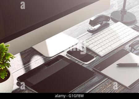 Designer's desk with responsive design mockup concept. - Stock Photo