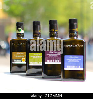 A selection of 4 different oils sat on a marble table in central London. - Stock Photo