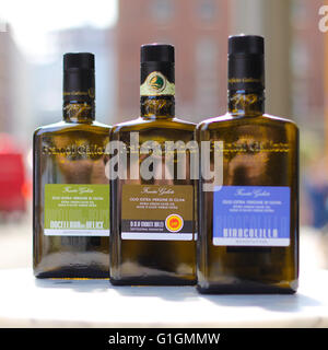 A selection of 3 different oils sat on a marble table in central London. - Stock Photo