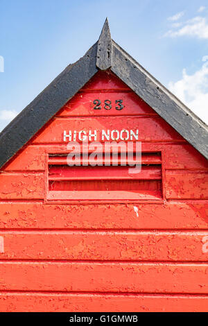 High Noon name on a red beach hut, Herne Bay, Kent, England, UK - Stock Photo