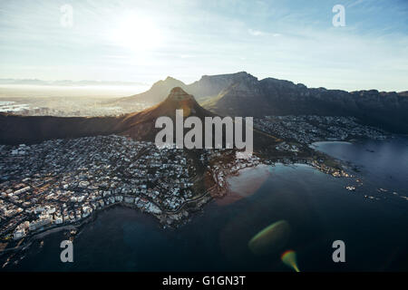 Birds eye view of city of cape town with beautiful beaches and mountain range on a sunny day. Aerial view of Cape - Stock Photo