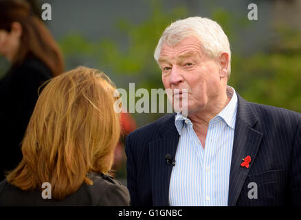Paddy Ashdown, former leader Liberal Democratic Party, being interviewed for TV on College Green, Westminster..... - Stock Photo