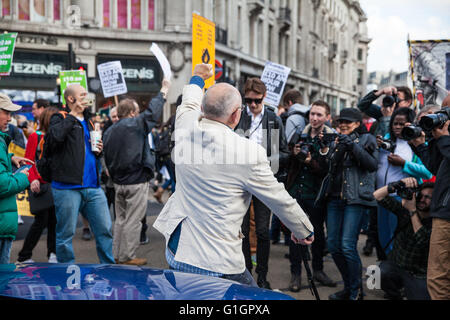 London, UK. 14th May, 2016. Ian Bone of Class War poses for a photo in Oxford Circus during a protest for a living - Stock Photo