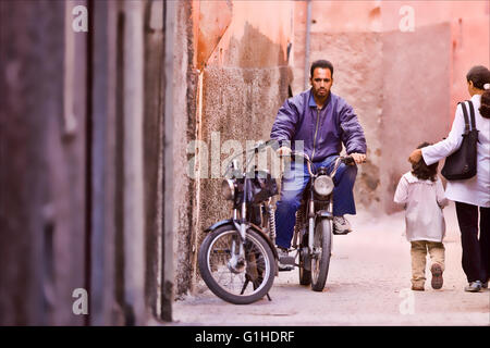 Street scenes of ordinary people going abouttheir business in marrakech, Morocco. - Stock Photo