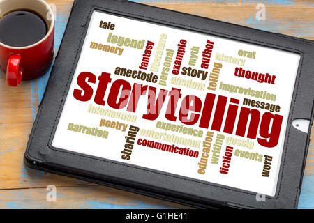 storytelling word cloud on a digital tablet with a cup of coffee - Stock Photo