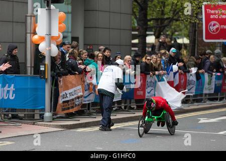 Wheelchair athlete at the London Marathon - Stock Photo