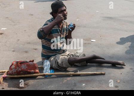 Crippled Beggar, Hyderabad - Stock Photo