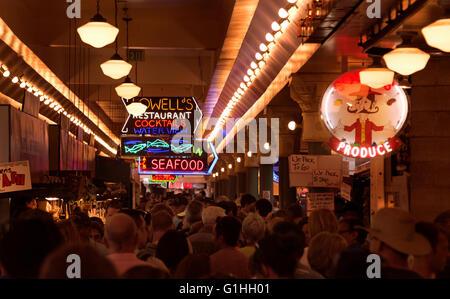A crowd is seen in side Pike Place Market in Seattle, Washington, USA (Adrien Veczan) - Stock Photo
