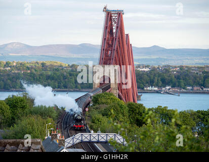 The Flying Scotsman steam train arriving at North Queensferry station after crossing the Forth Rail Bridge on a - Stock Photo