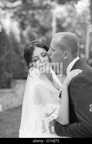 Gentle groom kiss - Stock Photo