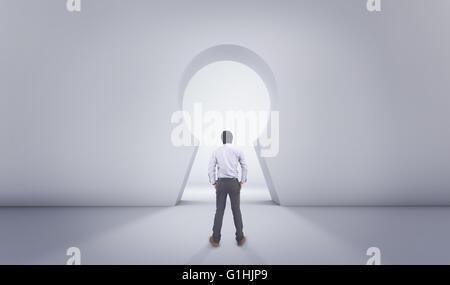 Asian Man Standing In Front of Big Lock Hole Door - Stock Photo