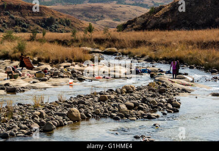 Washing laundry in the river at a village in the foothills of the Drakensbergs, KwaZulu Natal, South Africa - Stock Photo