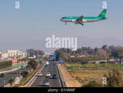 An Aer Lingus Airbus A320 coming in over the N348 highway to land at Malaga-Costa del Sol airport Malaga, Malaga - Stock Photo