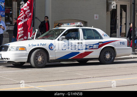 Toronto Police Cruiser parked outside Tim Hortons coffee shop in downtown Toronto, Ontario Canada - Stock Photo