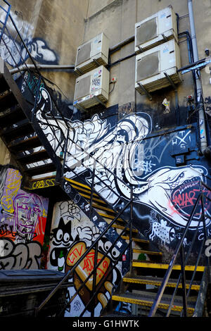 fire escape stairwell with graffiti in East London - Stock Photo