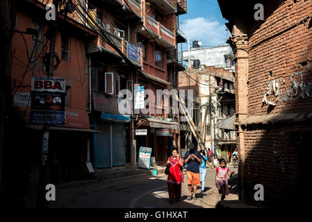 Local people passes through an alley in the old city of Bhaktapur, Nepal. © Reynold Sumayku - Stock Photo