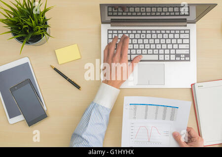 Data input and analysis at office - Stock Photo