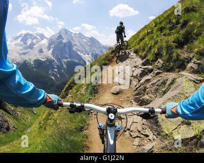 Two men mountain biking, Dolomites, Italy - Stock Photo