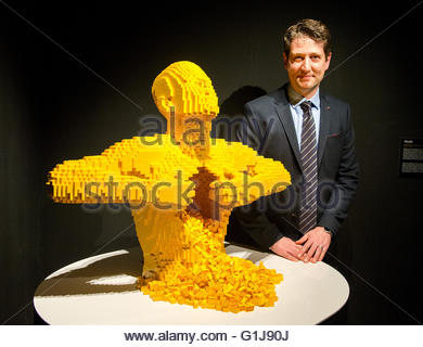 American artist Nathan Sawaya poses next to his piece 'Yellow,' made of Lego blocks, in the exhibition 'The Art - Stock Photo