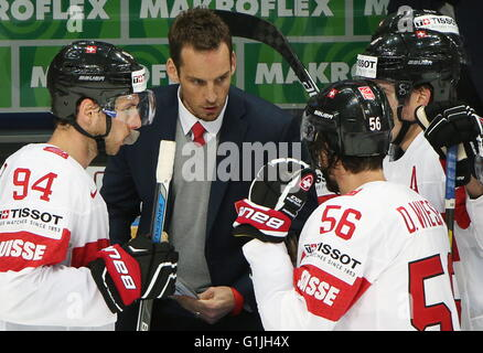 Switzerland's head coach Patrick Fischer (C) instructs Samuel Walser (L), Dino Wieser (R) in their 2016 IIHF World - Stock Photo