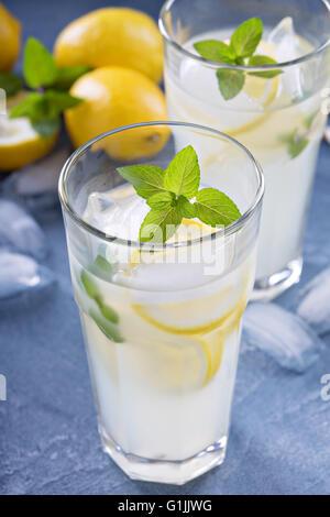 Classic lemonade on blue background - Stock Photo
